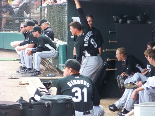 The guys taking in the game from the dugout