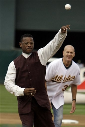 Rickey throwing out the first pitch.  Yes, I want video!!!